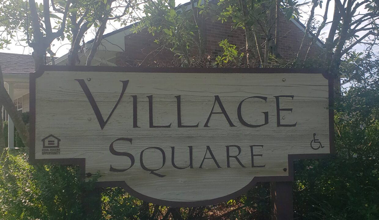 Village Square Apartments sign